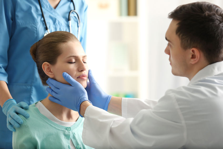 Young woman having meeting with plastic surgeon - dallas rhinoplasty