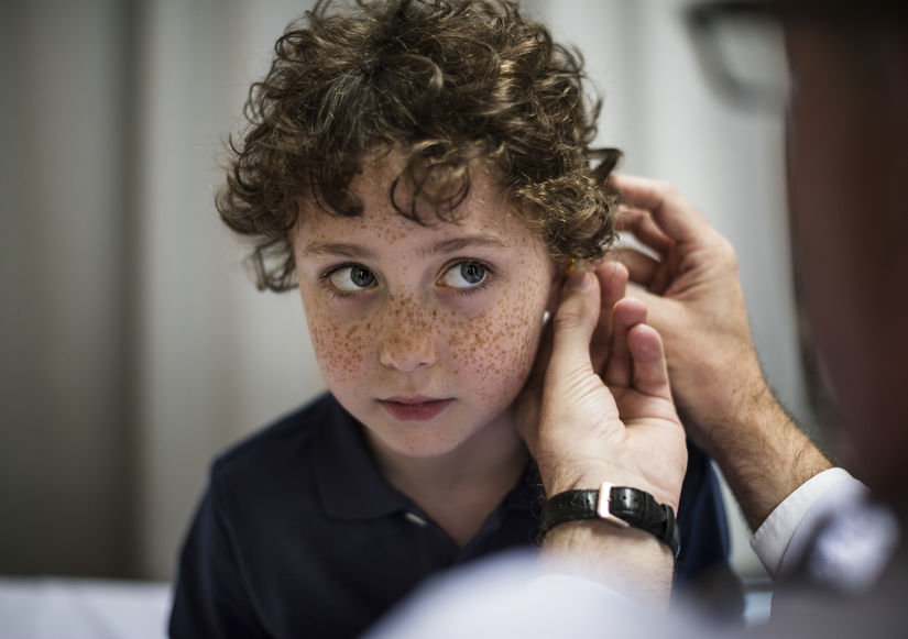 Young boy having his ears fitted for hearing aids, INfinity hearing
